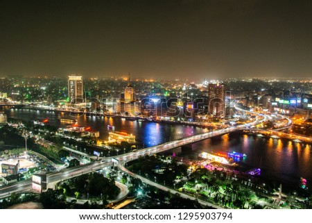 Cairo EGYPT 25.05.2018 Aerial view of Nile river and bridge at night illuminated from Cairo Tower - Egypt #1295903794