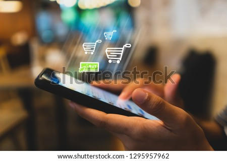 Women hand using smartphone do online selling for people shopping online in black friday with chat box, cart, dollar icons pop up. Social media maketing concept. #1295957962