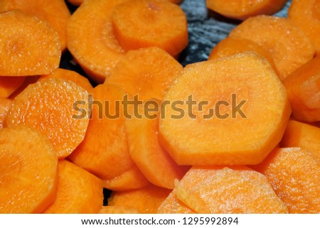 Carrots cleaned, cut and prepared for cooking. #1295992894