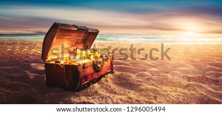 open treasure chest filled with golden items at sunset #1296005494