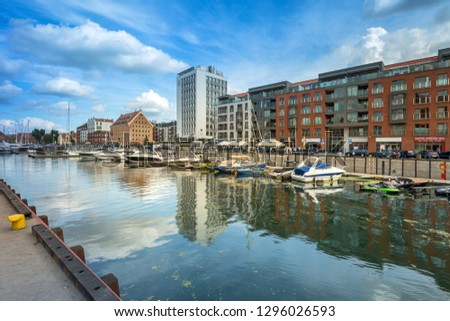 Gdansk, Poland - September 1, 2018: Architecture of the old town in Gdansk at Motlawa river, Poland. Gdansk is the historical capital of Polish Pomerania with medieval old town architecture. #1296026593