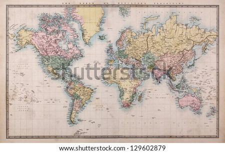 Original old hand coloured map of the World on Mercators projection circa 1860,the countries are named as they were then i.e. Persia, Arabia etc. a few stains as expected for a map over 150 years old. Royalty-Free Stock Photo #129602879