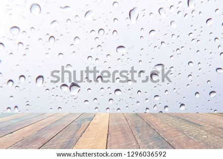 Water drops , Rain droplets on white background and empty wood desk .Blank space for text and images. #1296036592
