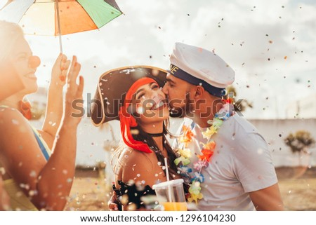 Brazilian Carnival. Couple in costume enjoying the carnival party in the city #1296104230