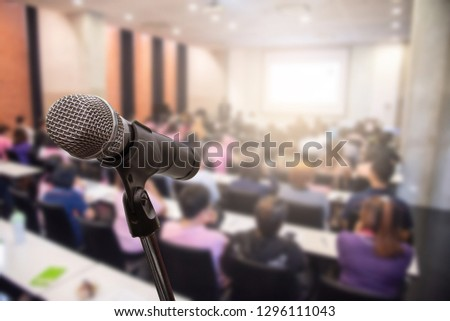 Microphone over the blurred business people forum Meeting or Conference Training Learning Coaching Room Concept, Blurred background. #1296111043
