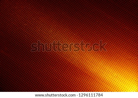 Narrow yellow ray of light on an orange background in a black dot #1296111784