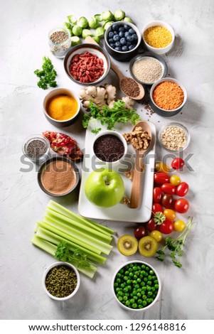 Vegetables, fruit, grain, superfoods for vegan and vegetarian eating. Clean eating. Detox, dieting food concept #1296148816