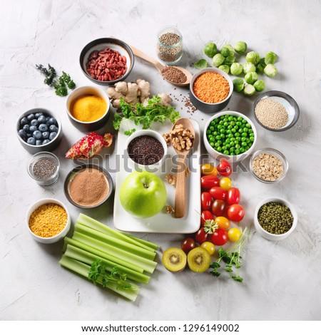 Vegetables, fruit, grain, superfoods for vegan and vegetarian eating. Clean eating. Detox, dieting food concept #1296149002