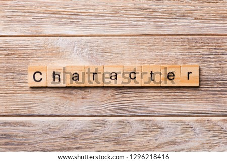 CHARACTER word written on wood block. CHARACTER text on wooden table for your desing, concept. Royalty-Free Stock Photo #1296218416
