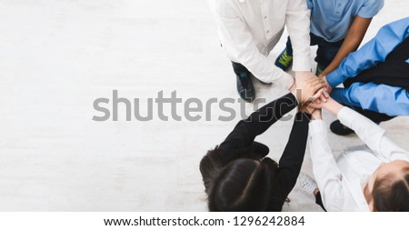 Unity concept. Children putting their hands together, top view, copy space #1296242884