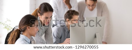 Horizontal photo female mentor explain intern corporate software online task point at pc screen, assistance and help concept. Horizontal photo banner for website header design with copy space for text