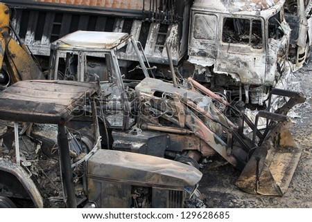 HALKIDIKI,GREECE-FEB 17:Group of 40 men threw molotov cocktails & set fire to equipment at the Hellenic Gold site, damaging containers, cars & trucks in the northern region of Halkidiki, Feb. 17, 2013 #129628685