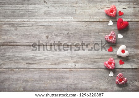 Valentines day background with handmade  textile hearts over wooden table #1296320887