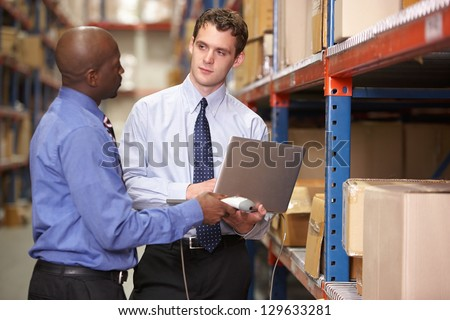 Two Businessmen With Laptop In Warehouse #129633281