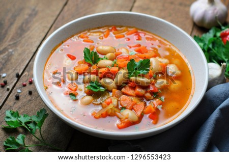 Vegetable Soup with White Beans, Homemade Soup on Dark Wooden Background, Vegetarian Food, Top View #1296553423