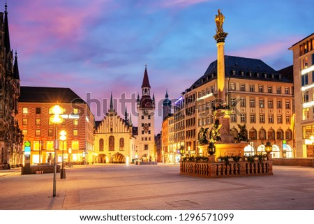 Munich Old town, Marienplatz square and the Old Town Hall tower, Germany, on dramatical sunrise #1296571099
