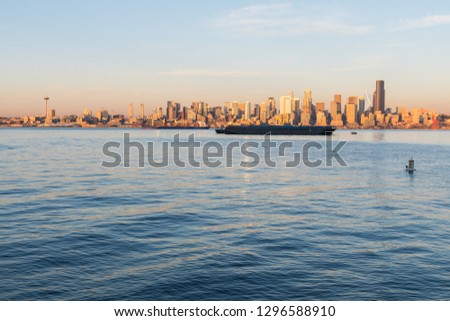 Views of Elliott Bay, Seattle Bay, with sunset light over the skyscrapers of downtown in the background, Washington, USA. #1296588910