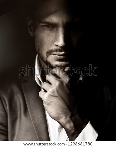 Portrait of a handsome man, fine art photo style #1296661780