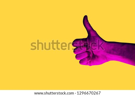 Isolated hand photo on yellow background. Pink hand collage style. Bright pop art template with space for text. Creative minimalistic backdrop. Poster, banner idea. Gestures with fingers