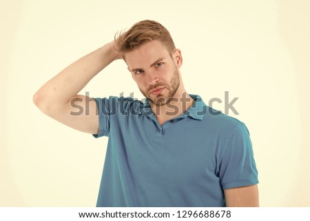 Fashion model touch stylish hair isolated on white background. Man with beard on unshaven face skin. Bearded man in blue tshirt. Skincare and barber salon. Style or trend and hairstyle concept. #1296688678