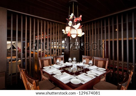 banquet table in a restaurant with a brown wooden interior #129674081