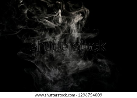 Abstract powder or smoke isolated on black background #1296754009