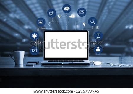 Digital marketing. laptop computer with white screen blank and virtual icon digital marketing network connection. Digital transformation and management business, media technology, blue tone. Royalty-Free Stock Photo #1296799945