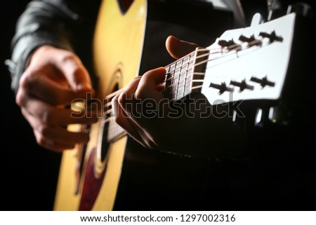 Young men playing the guitar with black background #1297002316
