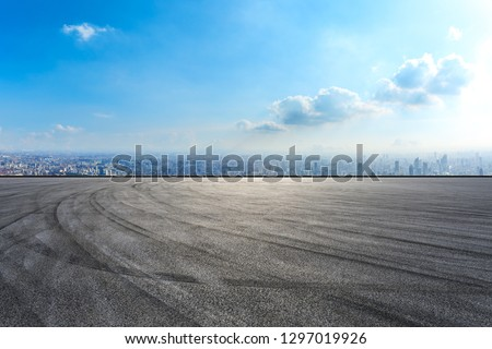 Empty asphalt road and city skyline in Shanghai,high angle view #1297019926