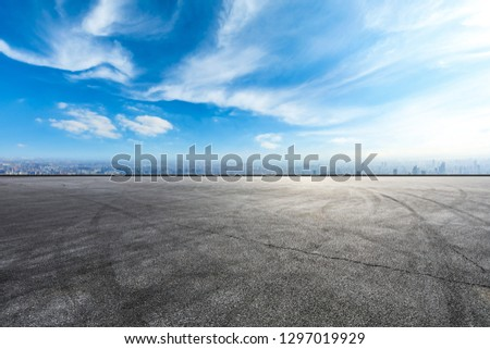 Empty asphalt road and city skyline in Shanghai,high angle view #1297019929