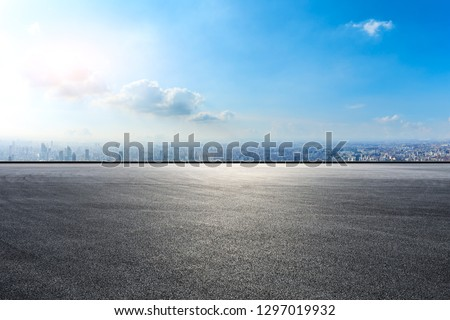 Empty asphalt road and city skyline in Shanghai,high angle view #1297019932
