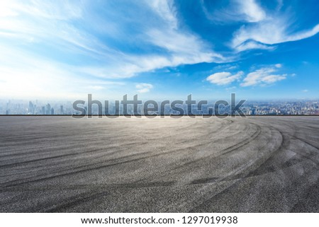Empty asphalt road and city skyline in Shanghai,high angle view #1297019938