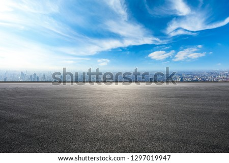 Empty asphalt road and city skyline in Shanghai,high angle view #1297019947