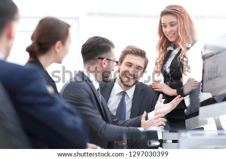 employees discussing financial charts #1297030399