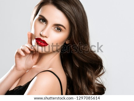 Beauty Woman face Portrait. Beautiful Spa model Girl with Perfect Fresh Clean Skin. Brunette female looking at camera and smiling on gray background. Beautiful hairstyle Youth and Skin Care Concept #1297085614