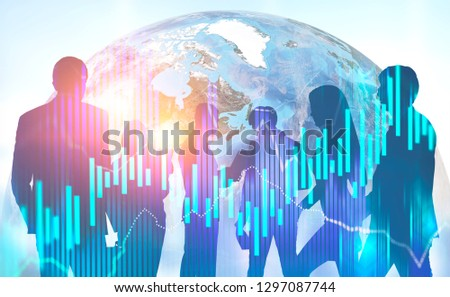 Silhouettes of business people working together over Earth image with double exposure of graph. International company concept. Toned image. Elements of this image furnished by NASA #1297087744