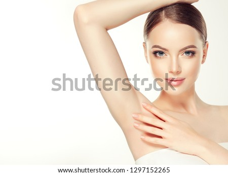 Armpit epilation, lacer hair removal. Young woman holding her arms up and showing clean underarms, depilation  smooth clear skin .Beauty portrait. #1297152265