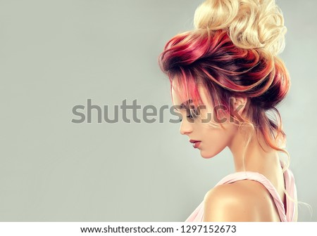 Beautiful model girl  with elegant  multi colored hairstyle . Stylish Woman with fashion  hair  color highlighting.   Creative  red and pink roots ,   trendy  coloring.  Royalty-Free Stock Photo #1297152673