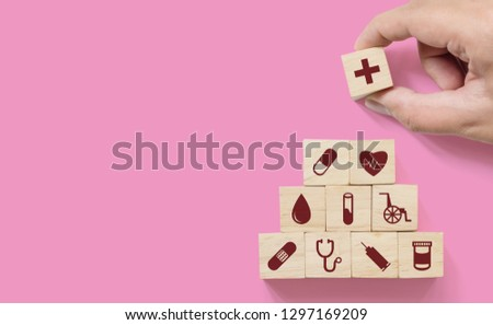 Hand arranging wood block stacking with icon healthcare medical, Insurance for your health concept #1297169209