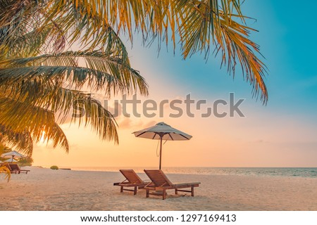 Beautiful beach. Chairs on the sandy beach near the sea. Summer holiday and vacation concept for tourism. Tranquil scenery, relaxing beach, wonderful tropical landscape design. Boost up color process #1297169413