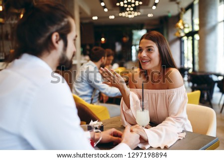 Young happy couple at a date in a coffee shop #1297198894