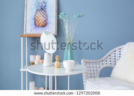Table with mirror and decor in modern room #1297202008