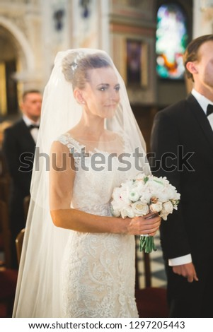Wedding couple bide and groom get married in a church #1297205443