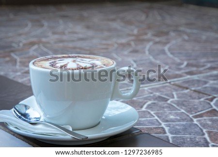 Hot mocha coffee. Cup of hot coffee with beautiful art. Morning Breakfast with coffee latte art. #1297236985