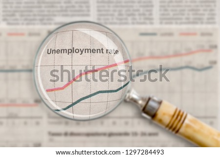 Unemployment rate under the glass Royalty-Free Stock Photo #1297284493