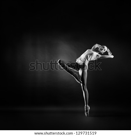 A portrait of young beautiful gymnast woman Royalty-Free Stock Photo #129731519