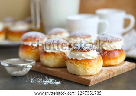 Homemade semla or vastlakukkel (in Estonia) is a traditional sweet roll with whipped cream made in Scandinavic and Baltic countries for Shrove Tuesday or related days #1297351735