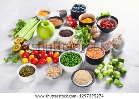 Vegetables, fruit, grain, superfoods for vegan and vegetarian eating. Clean eating. Detox, dieting food concept #1297395274