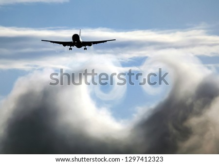 The turbulence of the clouds left by the plane during the flight. Royalty-Free Stock Photo #1297412323