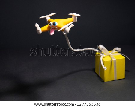 The drone Close up. Cartoon drone with the parcel. with a box